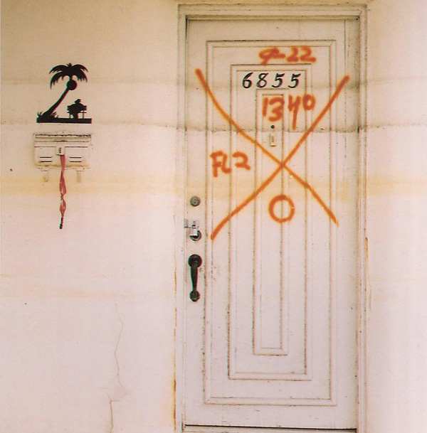 'X' mark and successive water lines on a door in Lakeview, New Orleans, 2007. Photograph by Christina Bray (http://www.southernspaces.org/2009/x-codes-post-katrina-postscript)