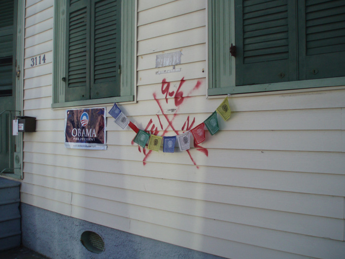 'X' mark in Bywater, New Orleans with Tibetan prayer flags, 2009. Photograph by Dorothy Moye (http://www.southernspaces.org/2009/x-codes-post-katrina-postscript)